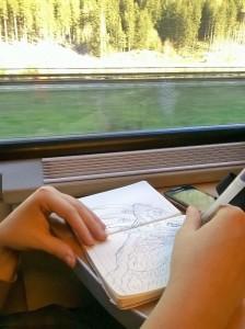 Giulia Zini disegna sul treno tornando da Monaco